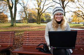 One WV college student working on her school assignment outdoors
