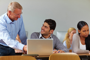 NM University Teacher Working with his Students